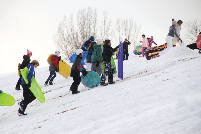The long march back to the top of the sledding hill at Goddard Middle School.