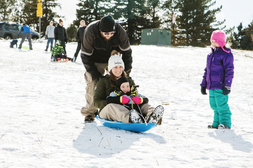 The Burgei family enjoying sledding on a Saturday afternoon in South Jeffco.