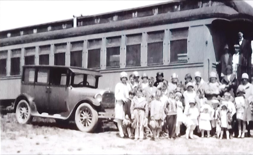 The Chapel rail car that was place on side tracks in Fort Lupton 1921, with member from the community. Sometimes the Chapel rail car would set in its location for a few weeks or months then moved to another town.