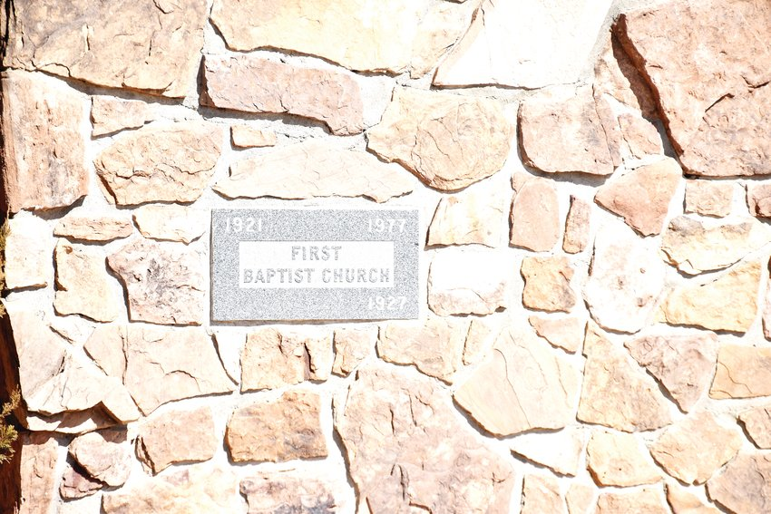 The plaque imbedded in the wall as a symbol of the church's history.