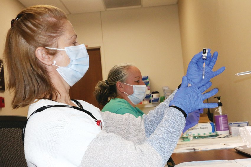 UCHealth Pharmacy Technicians Jessica Kurtz, left, and Eva Rozanski fill 500 syringes with the Pizer COVID-19 vaccine for the clinic held at the UCHealth Hospital in Highlands Ranch last week.