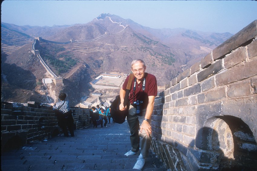 Lowell Georgia on assignment for the National Geographic Society atop the Great Wall of China.