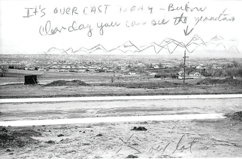 "Photo of the Arvada hills in 1960 by Lowell Georgia. ""Lowell made this photo from a spot near Carr St. and 68th Avenue, looking southwest over Arvada. He sketched in the mountains because it was a rare cloudy day and he wanted family back in Wisconsin to see his new city. The view has changed dramatically since that day in 1960,"" said Terry Georgia."