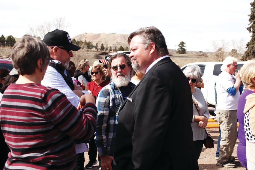 Douglas County Commissioner George Teal, right, speaks to attendees of a March 9 rally in Castle Rock.