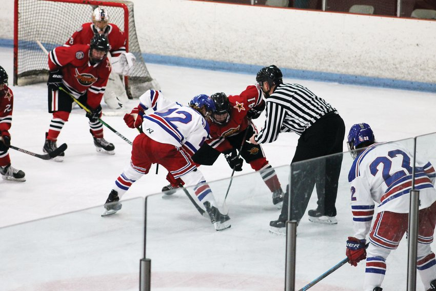 Tyler Samson (41) takes a faceoff against Gage Gaherty (12) of the Des Moines Buccaneers in Urbandale, Iowa.