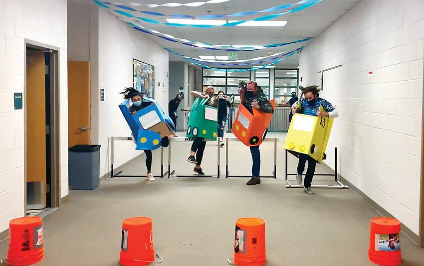 "Ralston Valley faculty members take part in ""Hot Wheels Racing,"" an event put on by the school as part of their annual Wish Week fundraiser."