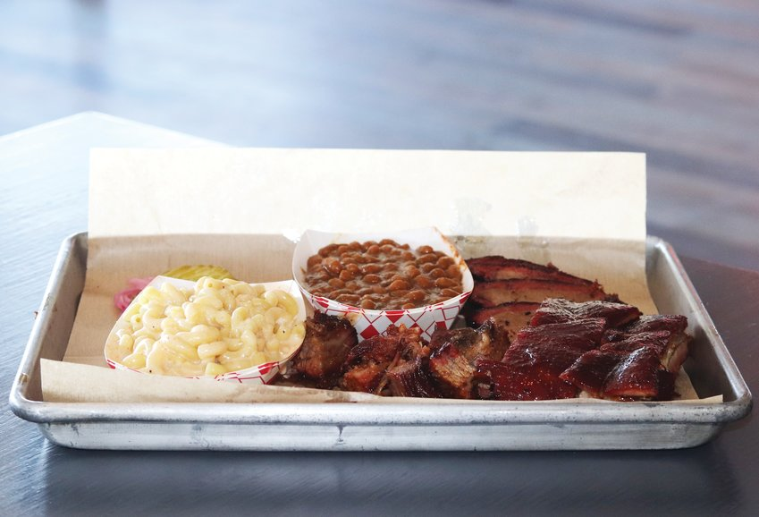 A sampling of Seasoned Swine's menu, including ribs, brisket, burnt ends, mac and cheese and baked beans.