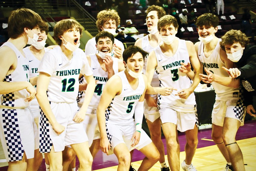 ThunderRidge basketball players celebrate their win in the Class 5A boys championship game. The victory marks the school's fifth state basketball championship.
