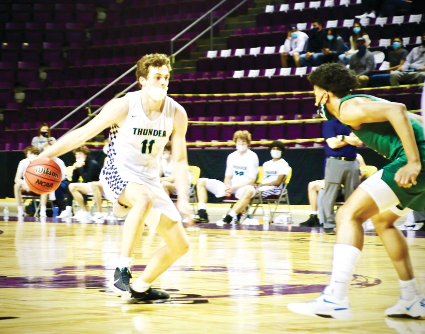 ThunderRidge's Nolan Marold (11) looks to make a move during the Class 5A state championship game, which was played March 20 at the Broadmoor World Arena. ThunderRidge won over George Washington, 68-59.