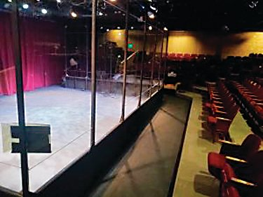 "A transparent barrier stands between audience seating and the stage at Town Hall Arts Center in Littleton, where ""You're a Good Man, Charlie Brown"" will be performed."