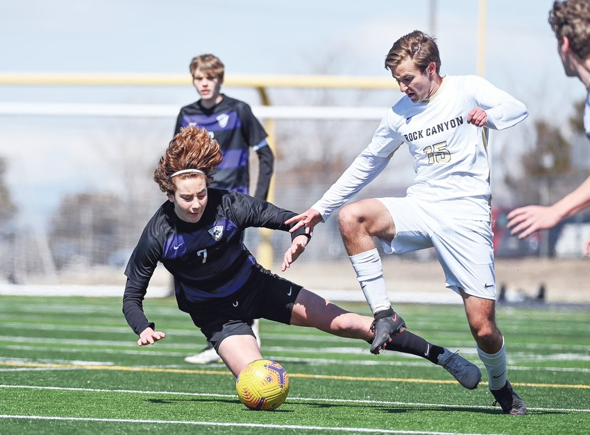 Douglas County's Tanner Rinker (7) looses his footing after getting tied up with Rock Canyon's Owen Loughlin (15).  The Jaguars took down the Huskies 3-0 at County Stadium in Castle Rock on Saturday.