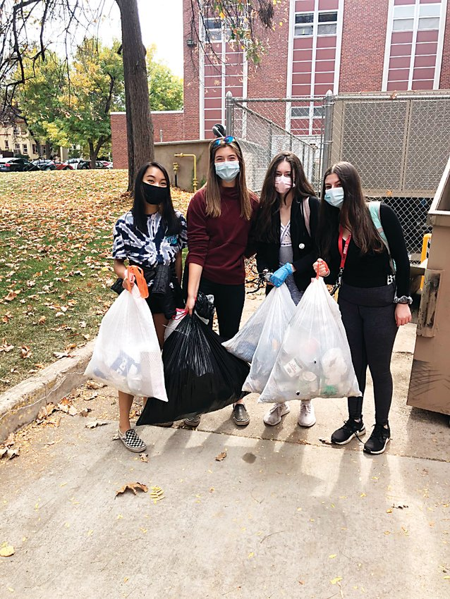 Four members of East High School's sustainability club participate in a trash pickup at City Park in Denver in October 2020.