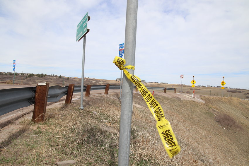 A piece of crime tape remained at the scene of a fatal officer-involved shooting April 4, 2021. The incident took place near the on ramp for I-25 N at Happy Canyon Road.