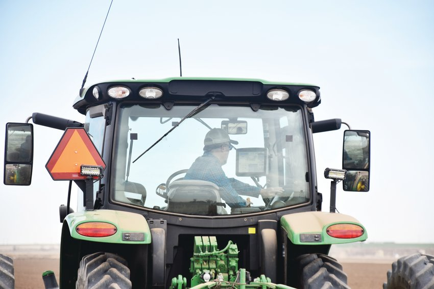Sakata operating his fully computerized tractor.  He stepped down as president from the Colorado Fruit and Vegetable board to representative the farmers of Colorado with the Colorado Water Conservative Board.