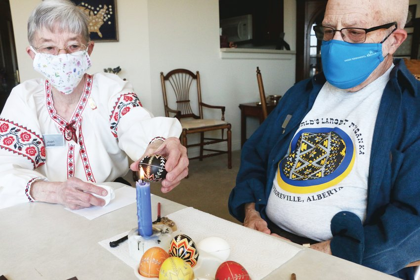 Joan and Chuck Jackson, of the Vi Senior Living Center in Highlands Ranch, working together to decorate Ukrainian Easter Eggs.