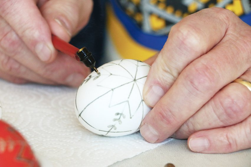 Designing the a Ukrainian egg takes several steps, starting with melted wax designs.