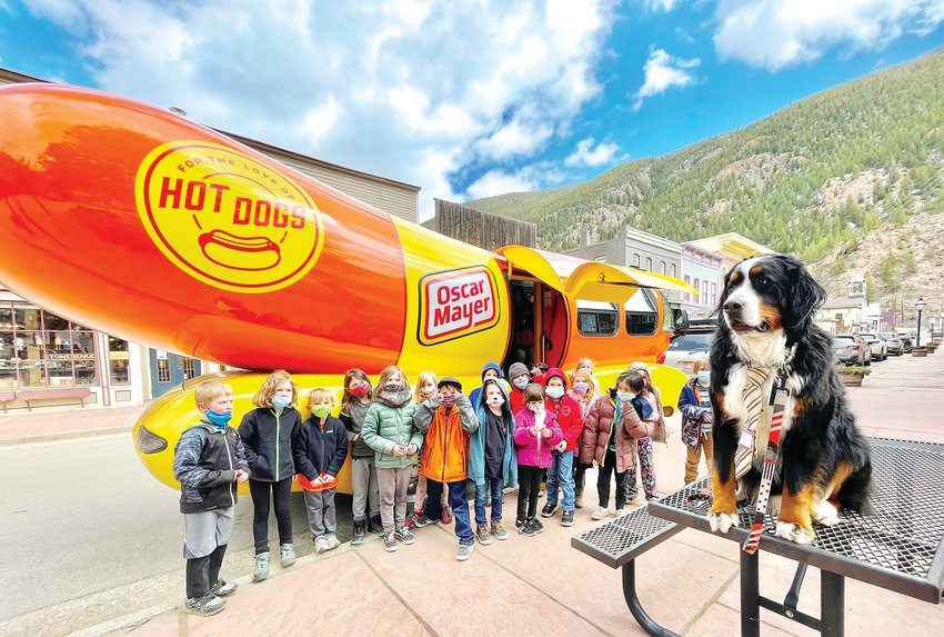 "Parker the Snow Dog, the honorary mayor of Georgetown, and Georgetown Community School students enjoyed a ""meat"" and greet with the Oscar Meyer Wienermobile on April 7. There are six Wienermobiles touring across the United States, and ""Big Bun"" visited downtown Georgetown last week."
