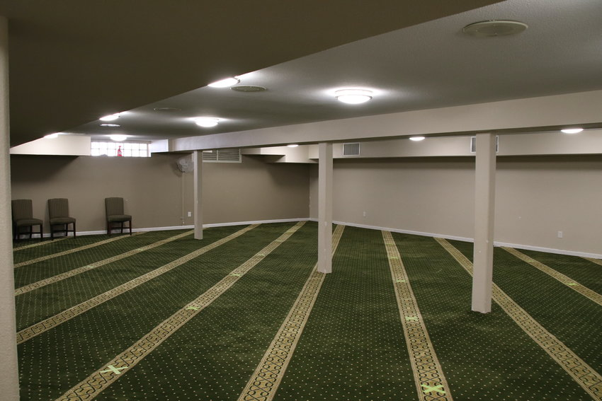 The women's prayer hall in the basement of Masjid Ikhlas, which has a carpet that is identical to the men's prayer hall located directly above the women's prayer hall.