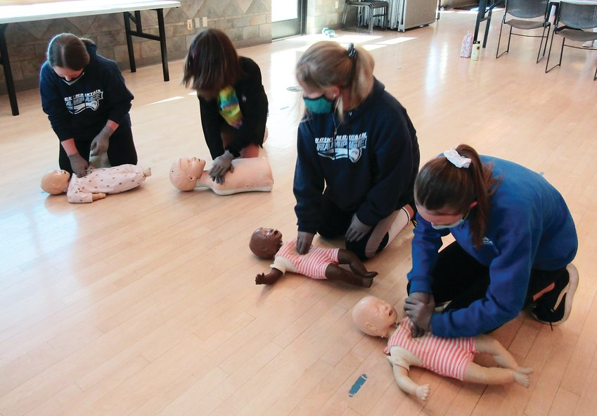 Participants in a babysitting class on April 10 at Buchanan Rec Center practice baby and child CPR techniques.