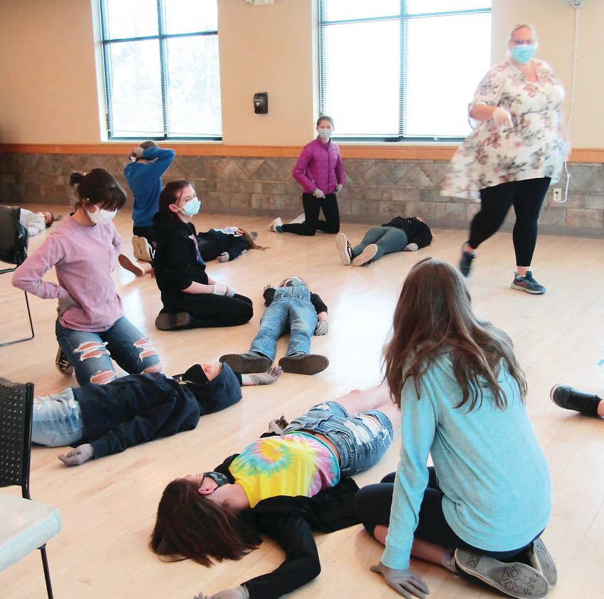 Instructor Amber Waller teaches participants in a babysitting class at Buchanan Rec Center on Saturday about the proper way to turn someone on their side.