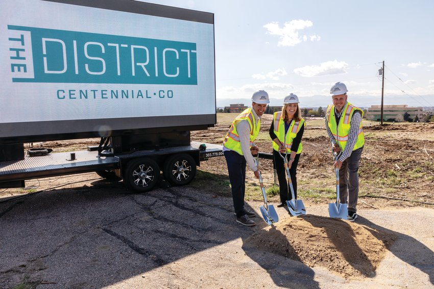 From left, Geoff Baukol, president and partner of Brue Baukol Capital Partners; Centennial Mayor Stephanie Piko; and Chad Brue, Brue Baukol CEO, pose at a ceremonial groundbreaking April 7 for The District, a development previously known as The Jones District.