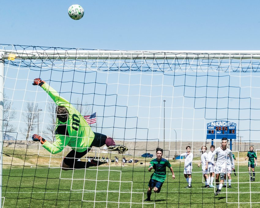 GHS goalie Connor McCormick makes a spectacular save as a Standley Lake Gator closes in on him. McCormick would make a similar leaping save on a direct fee kick from Conifer's Kellan Bundgaard in the first half to keep the game scoreless.