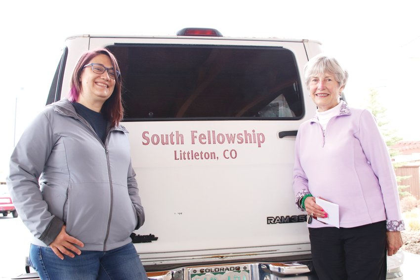 Erin Young, director of the South Fellowship Food Bank, left, and Vee Henderson, a Holly Creek Retirement Community resident, stand together during an April 15 pickup of donated food items at the retirement community in Centennial.