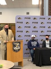 Prairie View baseball coach Mark Gonzales speaks about the athletic accomplishments of Marcus Sanchez, far right, during a letter-of-intent program at the school April 19.
