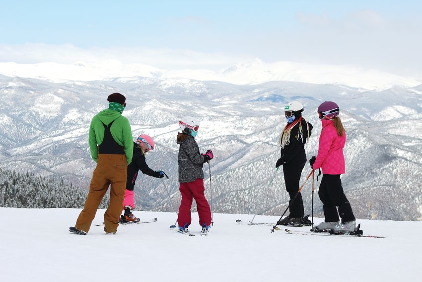 A group of skiers take in the view from Echo Mountain Resort Sunday morning.