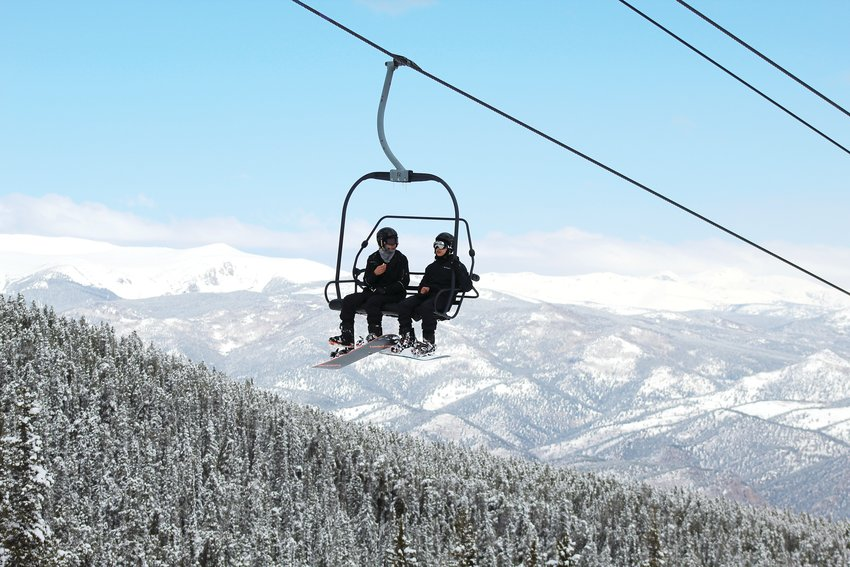 Snowboarders ride the lift Sunday during Echo Mountain Resort's final day for skiing and snowboarding.