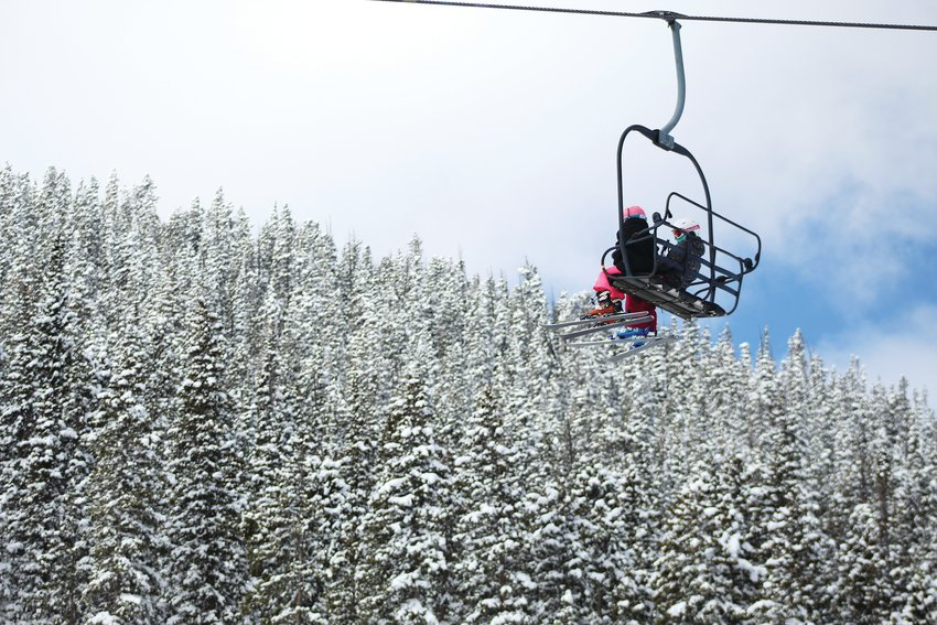 Two young skiiers ride the lift to the top of Echo Mountain Resort Sunday morning.