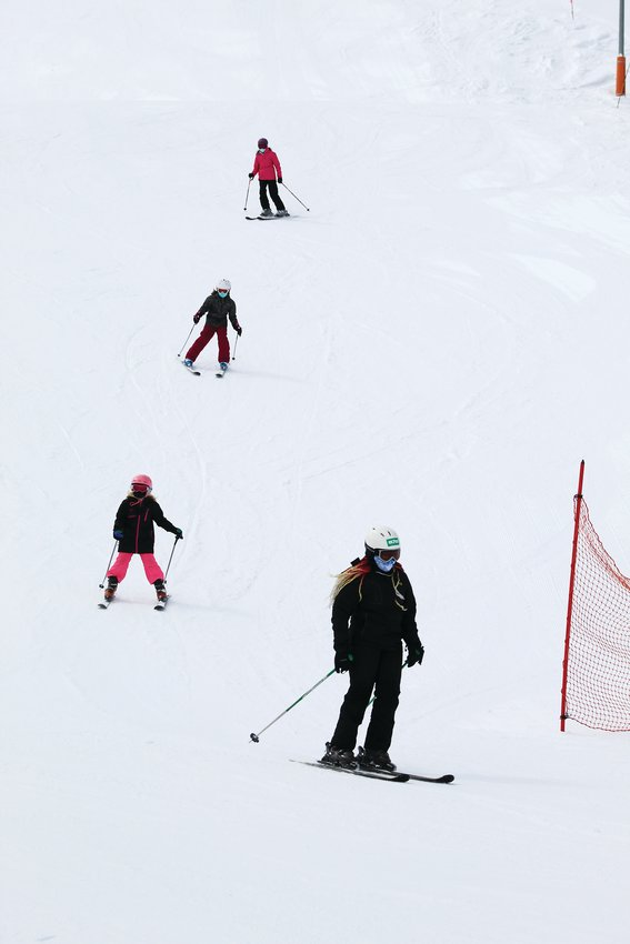A group of skiiers navigate the Full-Send run, which is adjacent to Echo Mountain Resort's lodge, Sunday morning. Echo Mountain hosted its final day of skiing and snowboarding Sunday, but it's planning to host tubing on the weekends through May 2.