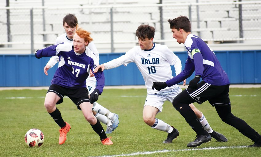 Arvada West junior Owen Welch (17) tries to breakaway from Valor junior Jaden Claycamp (10) during the scoreless tie Monday, April 12, at the North Area Athletic Complex.
