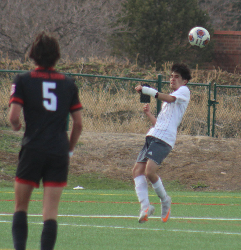 The Bludeevils' Brandon Ruiz heads the ball out of harm's way during the state 3A soccer playoffs April 22 at Colorado Academy. Nico Watters (5) of CA also is in the picture.