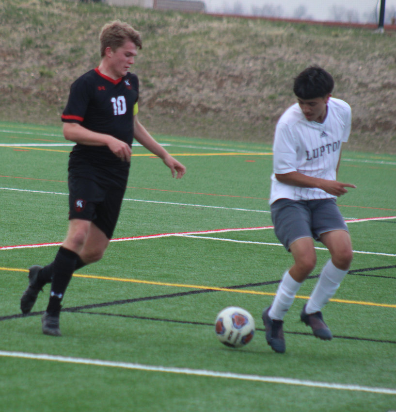 Colorado Academy's Luke Wharton, left, and Fort Lupton's Jovanny Sixtos keep their eyes on the loose ball during the first round of the state 3A soccer tournament April 22.