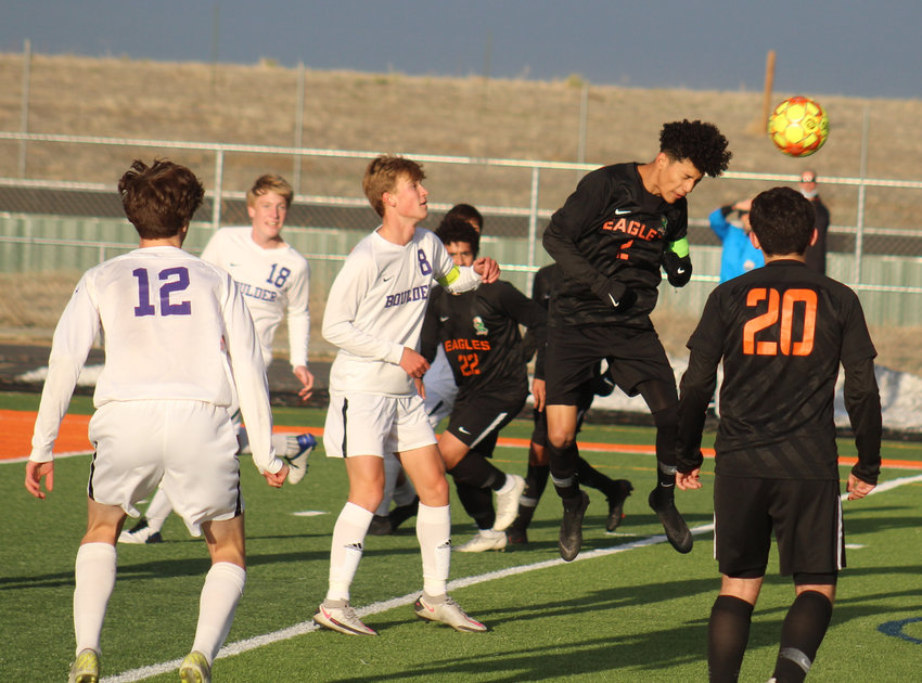 Adams City's Gabriel Ortega heads the ball out of danger during the first round of the state 5A soccer tournament April 22. Boulder's Cameron Gerber (8), Oliver English (18) and Calvin Pielke (12) as well as the Eagles' Mauricio Alipizar (22) and Alejandro Rodriguez (20) are in the picture.