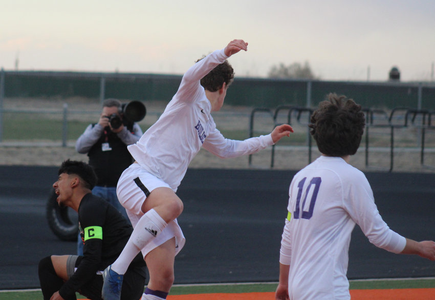 Andy Galvan of Adams City, left, gets the worst of this exchange with Boulder's Micah Garry during the first round of the state 5A soccer tournament April 22 in Commerce City.
