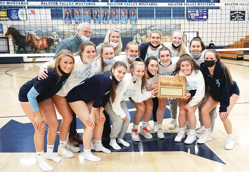Ralston Valley's girls volleyball team poses with the Class 5A Jeffco League title plaque on April 21 after the Mustangs defeated Valor Christian 3-0. It's Ralston Valley's first volleyball conference title since 2015.
