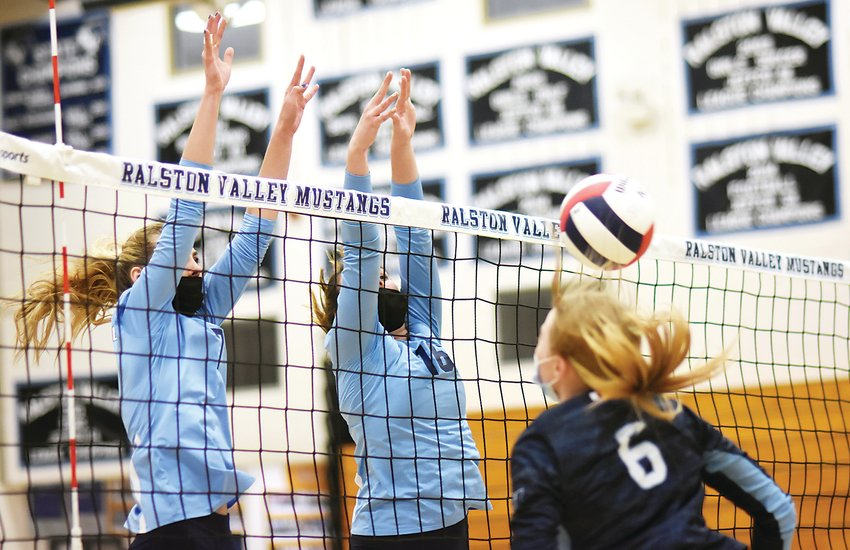 Ralston Valley junior Jordan Wisner (7) and senior Jamie Dorczuk (16) combine for a block on Valor sophomore Skyla Morgan in the first set April 21 at Ralston Valley High School. The Mustangs took a straight-set victory over the Eagles in the final regular-season home match for Ralston Valley.