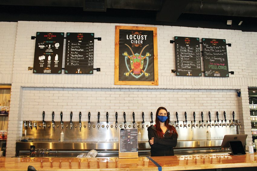 Sarah Mutch, taproom manager, stands behind the bar of Seattle-based Locust Cider's new Belmar location. The taproom features 16 ciders on tap, others in cans, a few wines and a small-plate food menu.