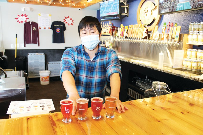 Luke Furey, operations manager at Golden's Colorado + 49 Cidery & Pub, assembles a flight of ciders. The cidery offers flights of five and will be releasing 13 new ciders at its third-anniversary celebration in late June.