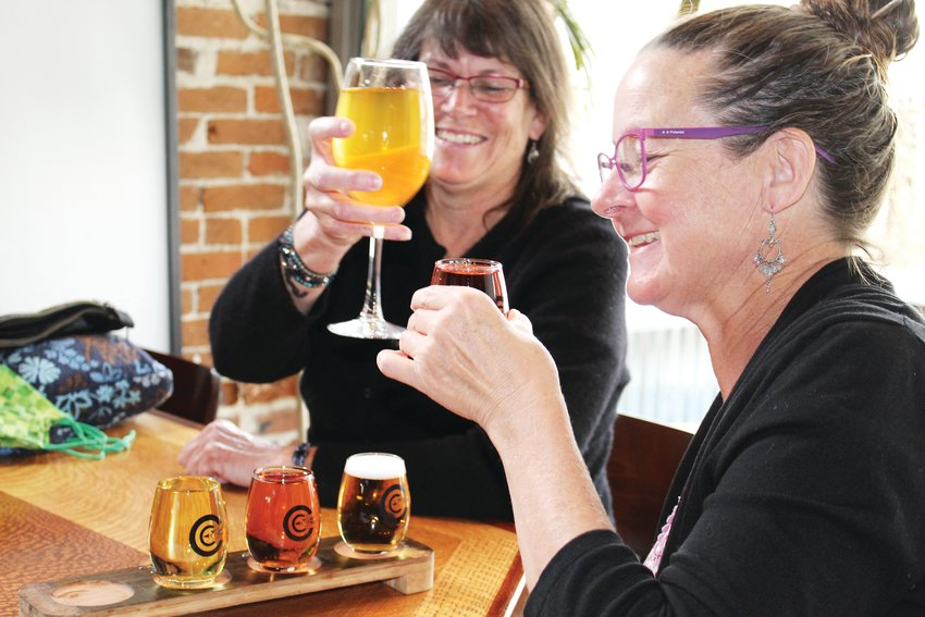 Deb Evangelista, foreground, and Sarah Holloway, both of Longmont, enjoy ciders at Clear Creek Cidery & Eatery in Idaho Springs on April 20. The two were visiting the hot springs for the day and stopped by the cidery for dinner, saying they appreciate cider as a gluten-free alternative to other alcoholic drinks.
