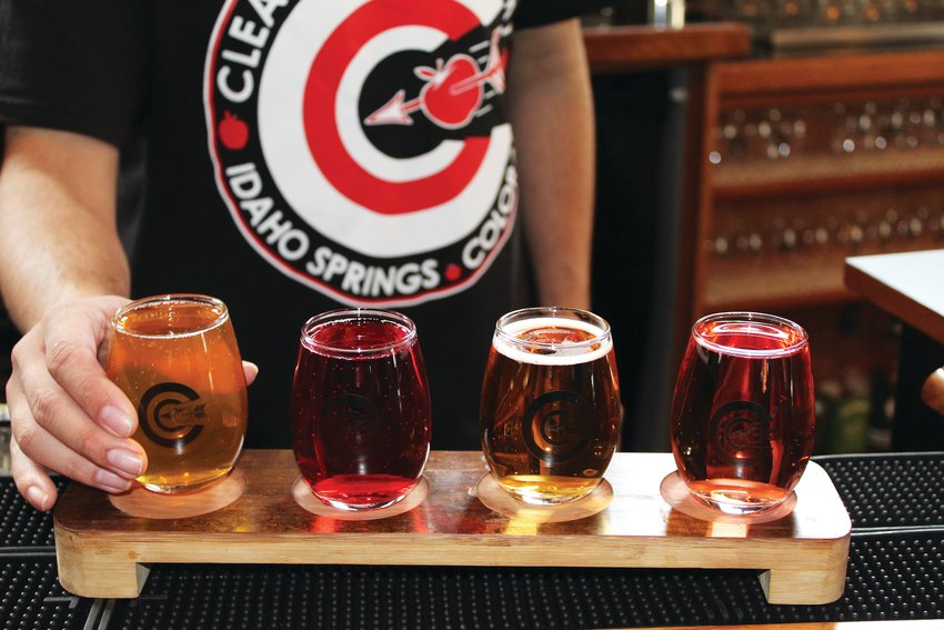 Sam Al-Jassim, a Georgetown resident and manager at Clear Creek Cidery & Eatery, pours a selection of cider for a flight of four. This cidery in Idaho Springs hopes to launch its own line of ciders later this year, and currently features nine Colorado ciders on tap and 14 others in cans.