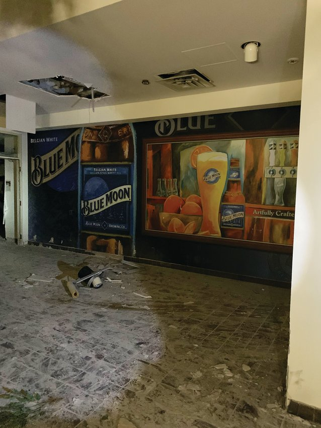 A mural dedicated to Coors' Blue Moon brand is visible in the building.