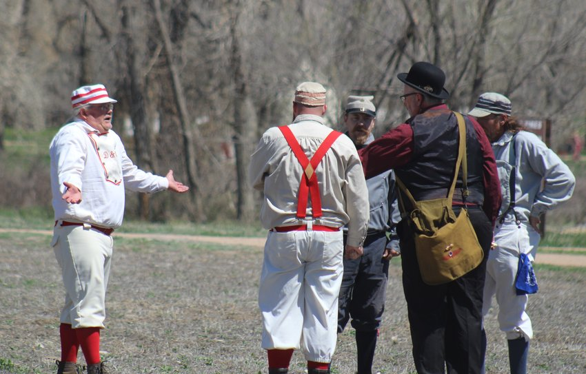 "This is an 1860s- style ""rhubarb,"" minus replay. The discussion was whether a ball went fair or foul. The arbiter ruled that the two captains agreed the runner, ""Soda Boots"" (second from right) was out."