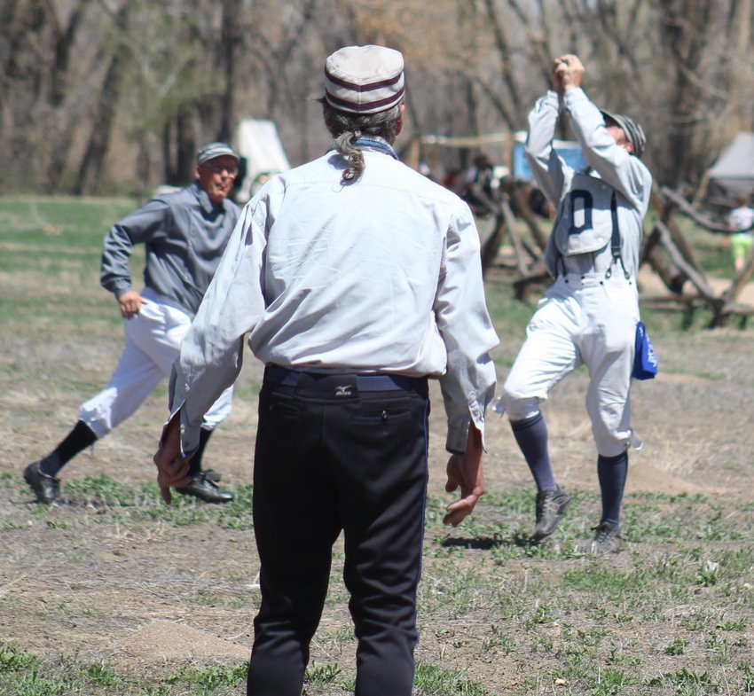 """Cannibal"" is the Blue Stockings manager and first baseman. Here, he makes a bare-handed grab of a pop fly."