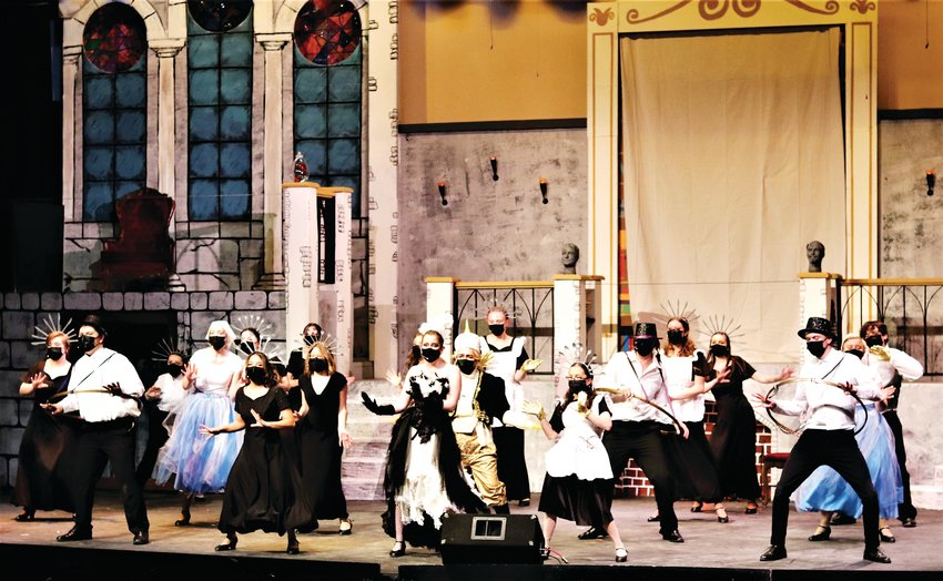 "Cast members from Golden High School's production of Beauty and the Beast perform the famous ""Be Our Guest"" number."