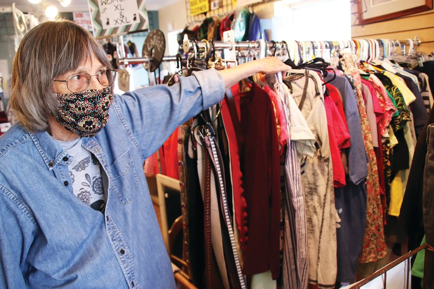Janet Yench, a volunteer for Soul Dog thrift shop in Englewood, talks on April 30 about the clothes in the store, which typically sell for just a dollar.
