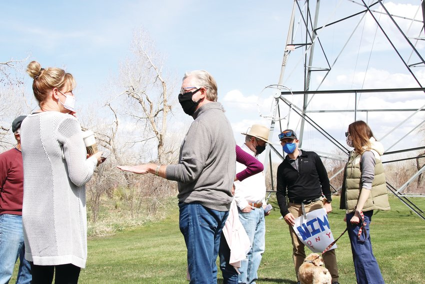 A man expresses concerns to Mary Jo Woolf, senior director of distribution business operation for Xcel Energy, on April 24 at a park in west Centennial. The man and other area residents met with Xcel at the park to discuss a plan that requires removal of trees in some residents' yards.