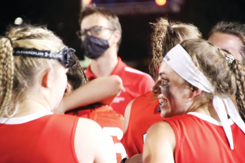 Regis Jesuit players were all smiles after a 2-1 double overtime win over Cherry Creek in the state championship girls field hockey game played April 29 at the Stutler Bowl. Regis coach Spencer Wagner is in the background.